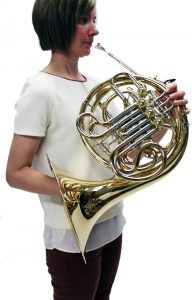 holding a french horn