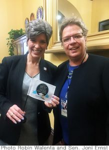Robin Walenta of West Music Presents Award to Iowan Senators